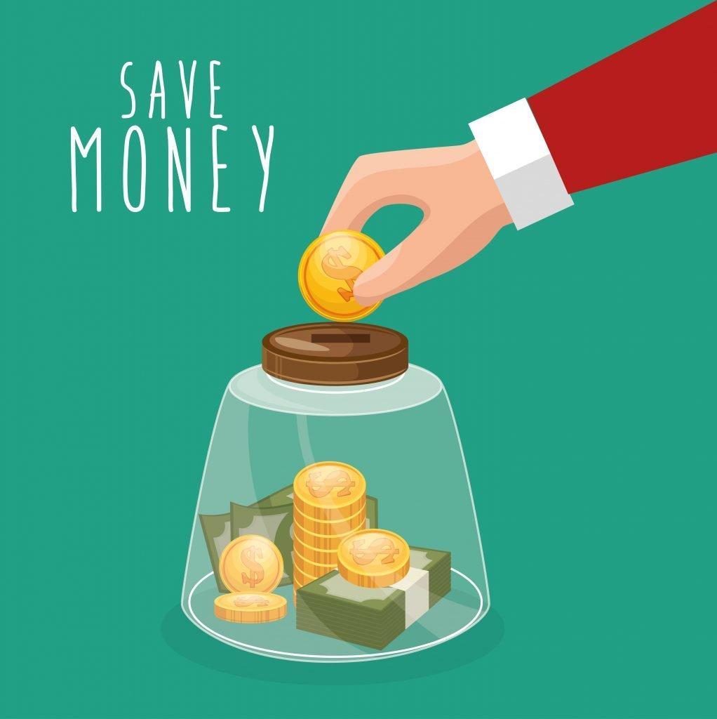 Käsi laittamassa kolikkoa säästöön